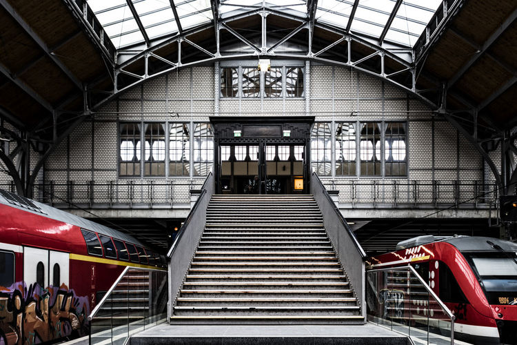 Central station Lübeck Architecture Built Structure Central Station Lübeck Day Hall Indoors  Lübeck, Germany No People Railings Railroad Station Railroad Station Platform Red Train Stairs Trains