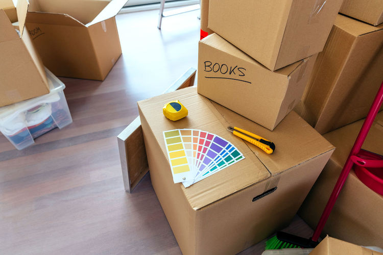 High angle view of color swatches on cardboard box at home
