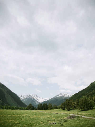 Landscape With Mountain Range In Background