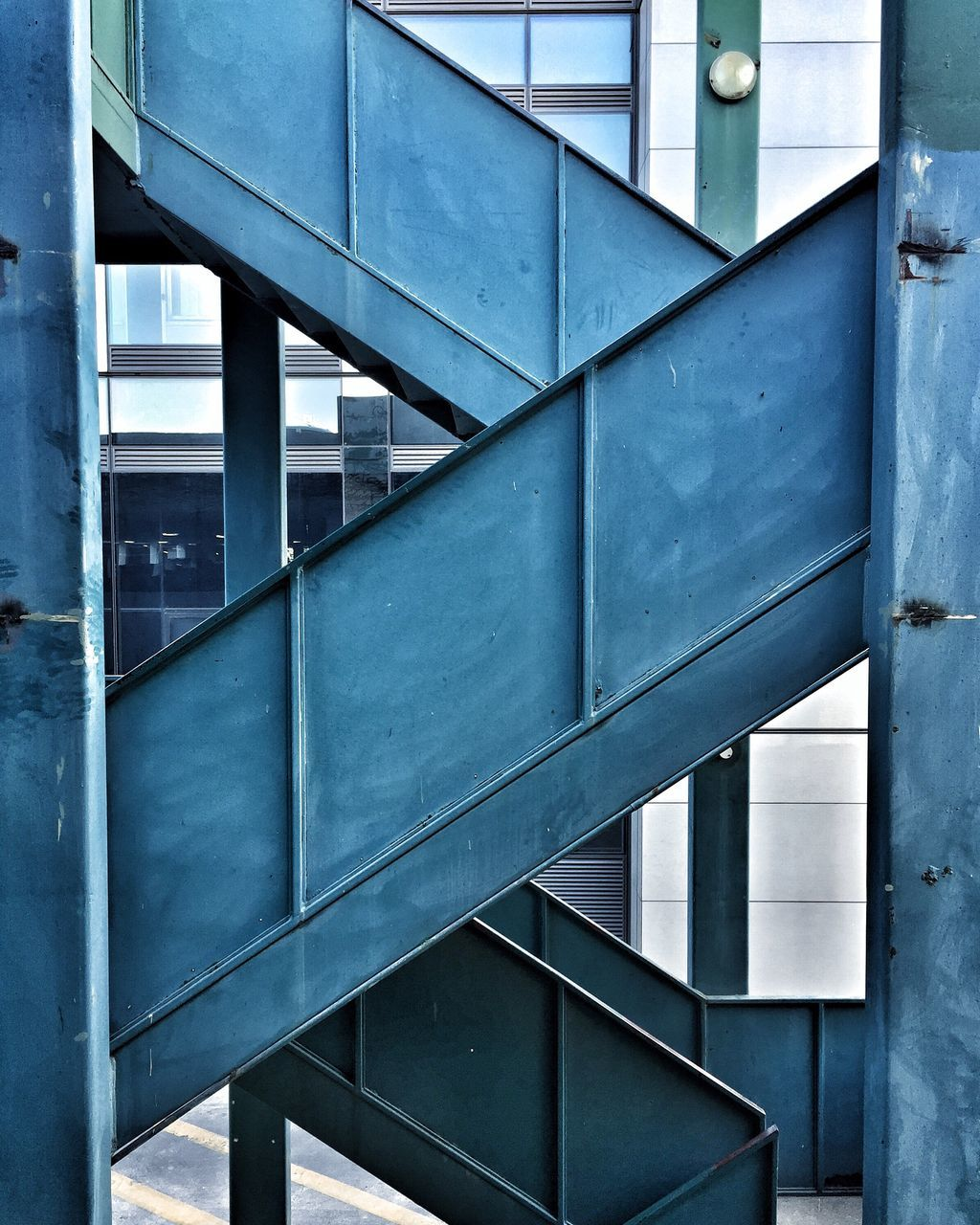 Metallic Staircases Against Building