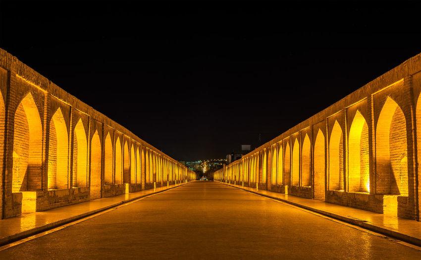 View of illuminated bridge at night