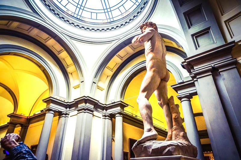 A photographer snaps away at Michelangelo's masterpiece, David. And the colour yellow adds some life to the marble hero about to slay his Goliath. Michelangelo's David The David Galleria Dell'accademia Marble Sculpture Art Gallery Sculpture Human Form Human Sculpture Renaissance Art Florence Accademia Academia Gallery Italian David Indoors  Interior Photographer Culture Famous Michelangelo Marble Florence Italy Paint The Town Yellow Yellow Masterpiece