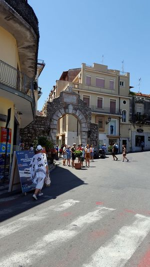 The Streets Of Taormina Italy Editorial Only Travel Destinations Vacation Time Beautiful Day Tourist Attraction  Tourism Taormina Italy Italy🇮🇹 History Through The Lens  Taormina Italia Beautiful Place Brick Building Arches Street Architecture City Street Road Built Structure Building Exterior Outdoors Day People