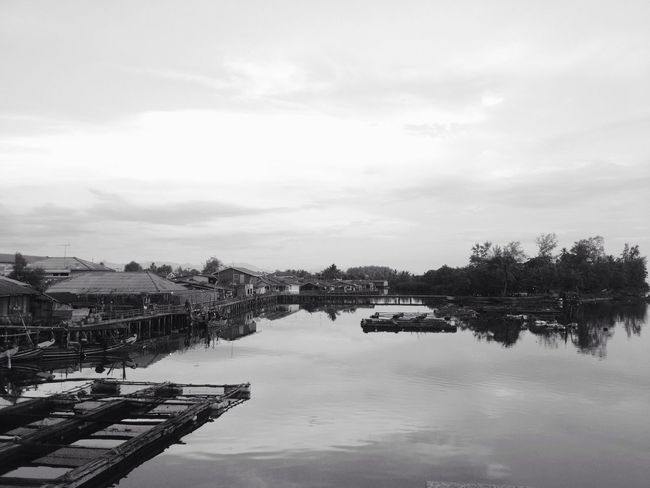 (B&W) fisherman village scene Water Architecture Built Structure Sky River Connection Building Exterior No People Fisherman Village Floating House Outdoors Nature Tree