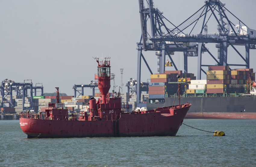 Lightship moored in Stour Estuary, Harwich, Essex, England. Cargo Container Coastal Commercial Dock Container Container Ship Day Freight Transportation Harbor Industry Lighthouse Lightship Mode Of Transport Moored Nautical Vessel No People Outdoors Sea Ship Shipping  Shipyard Sky Transportation Warning Water Waterfront