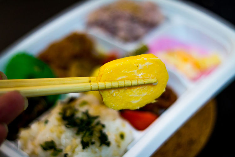 Bento Bold Colours Bright Choice Chopsticks Close-up Colorful Colour Of Life Eating Fingers Food Freshness Gorgeous Holding Japanese Culture Japanese Food Japanese Omelette Mealtime Onthetable Rolled Egg Selective Focus Show Us Your Takeaway! Studio Shot Variation Vivid Colours