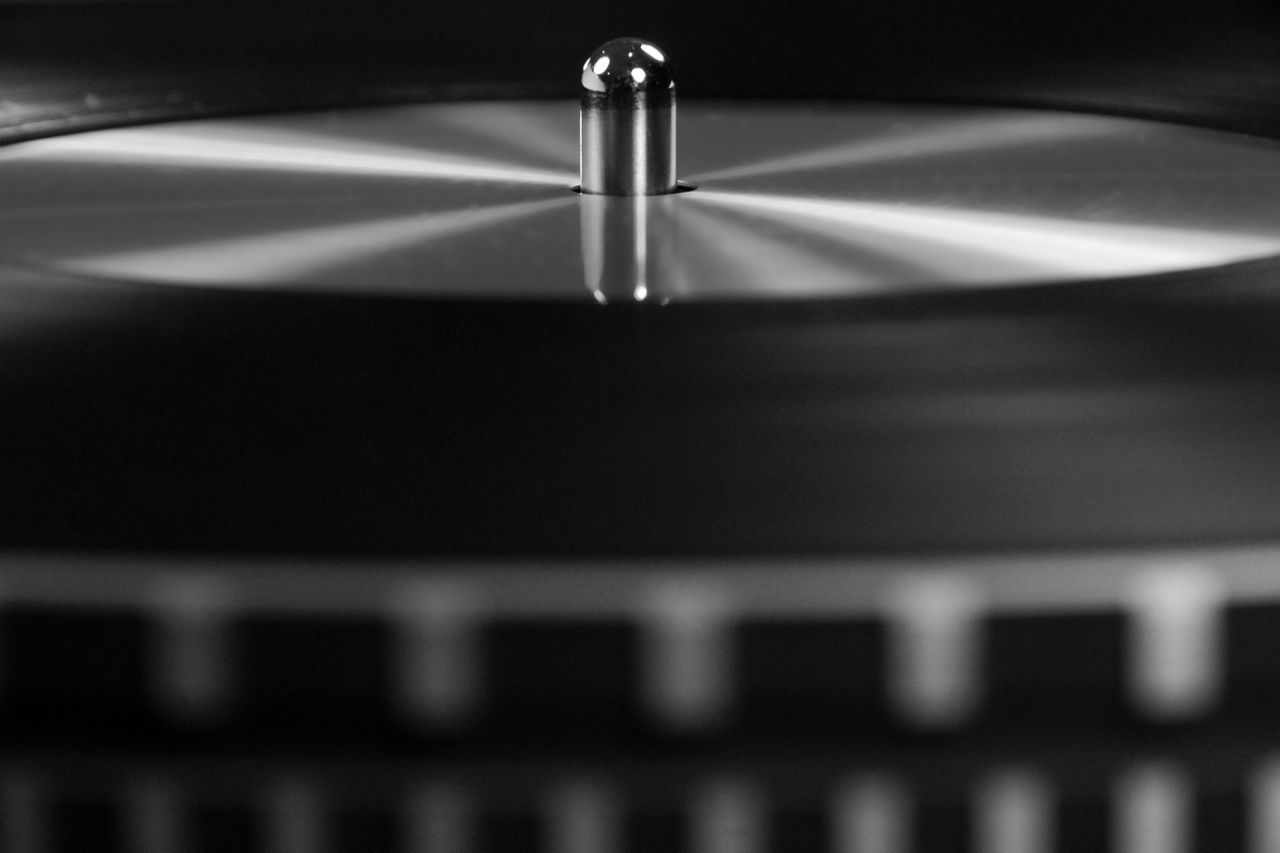 selective focus, close-up, no people, indoors, music, record player needle, day