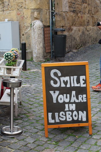 Welcome EyeEm City Lover Streets Of Lisbon Lissabon, Portugal Lisboa Portugal Lisbon - Portugal Streets Of Lisbon Text Communication No People Day Board Blackboard  Architecture Sign Wall - Building Feature Cafe Plant