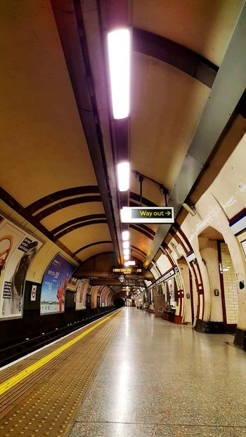 Way Out Sign Ceiling Architecture Indoors  Built Structure No People Illuminated Subway Train Tunnel Empty Platform Railroad Station Tube Travel Tube Station  Empty Empty Places Indoor Lighting Hyde Park Corner Subway Transportation The Way Forward Subway Station Architecture Indoors  Hyde Park Corner Station