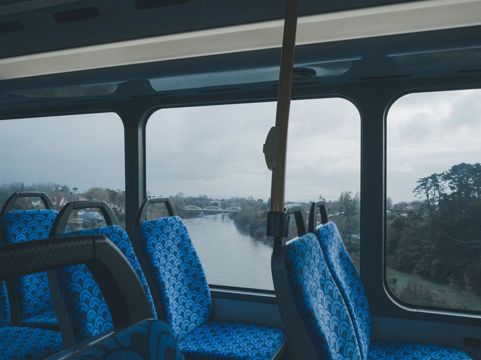 Empty seats in bus against river