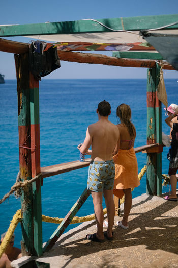 Holiday Mediterranean  Vacations Adult Bar Day Island Hopping Leisure Activity Lifestyles Men Nature Nautical Vessel Ocean Outdoor Bar Outdoors Paradise Real People Rear View Sea Shirtless Standing Tan Water Women