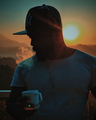 exhale your sadness Coffee Portrait Sunrise Smoke Cigarette  Mobilephotography One Person Only Men Drinking Men People Young Adult Adventure Outdoors Drink EyeEmNewHere