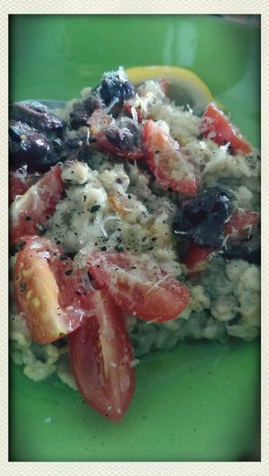 Yum! Savoury oregano Oats with Tomatoes, Kalamatas, Parmesan, and olive oil. A beautiful thing!! In My Kitchen