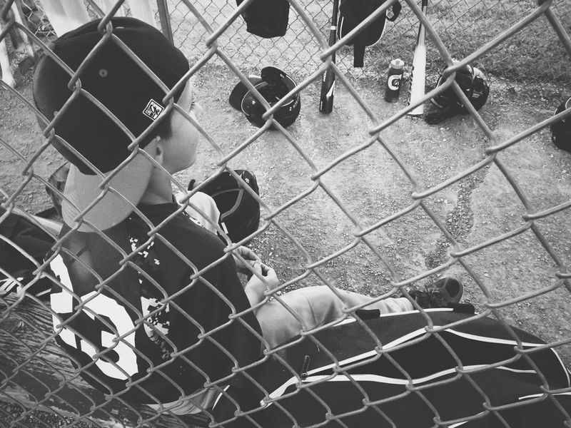Monochrome Photography Blackandwhite Black And White Boy Kid Child Childhood Sport Baseball Baseball Game Waiting Hat Uniform Fence Person Portrait Bat Ball Dugout Outside Outdoors
