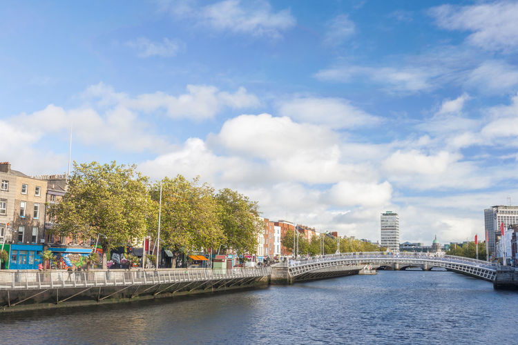 View of Hapenny Bridge over Liffey river in Dublin, Ireland Dublin Bridge Hapennybridge Lifey River Ireland Irish Europe City River Water Footbridge Dusk Landmark Destination Cityscape Penny Historic Building Attraction