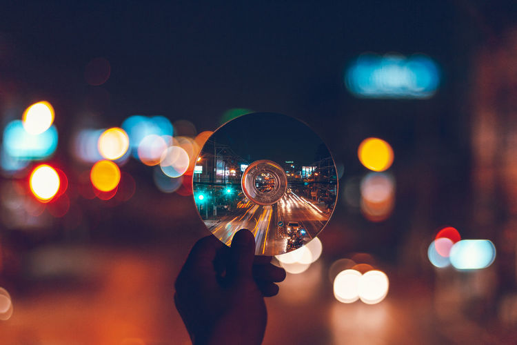 Small town in Thailand. Night Hand Focus On Foreground City Finger Nightlife Lens Flare Light Outdoors Architecture Close-up Bokeh Circle Blue Light Illuminated Night Lights EyeEmNewHere a new beginning The Week on EyeEm Dark Neon Neon Lights