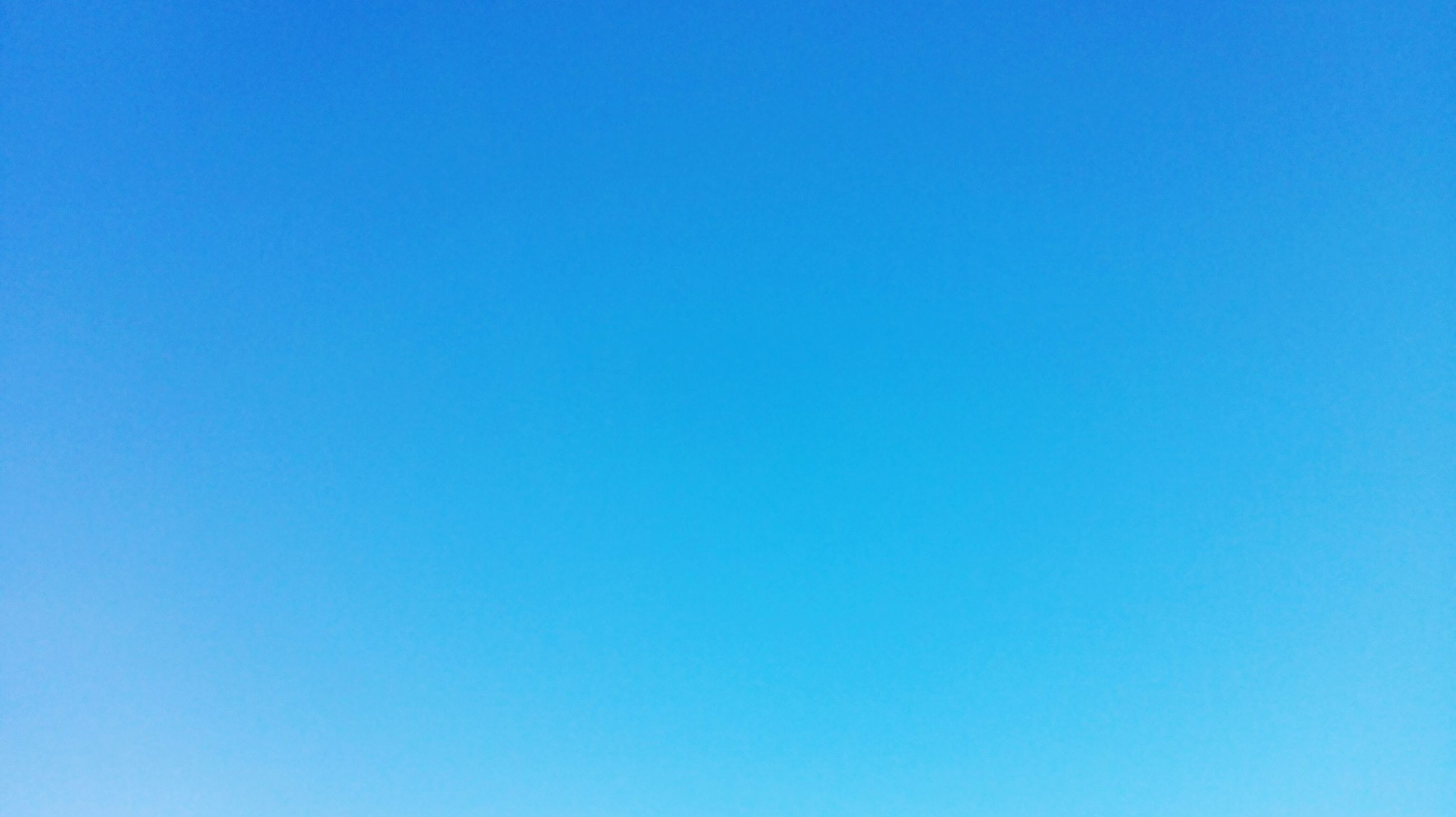 blue, copy space, clear sky, low angle view, beauty in nature, tranquility, nature, scenics, tranquil scene, outdoors, no people, day, idyllic, backgrounds, high section, sunlight, white color, sky, majestic, remote