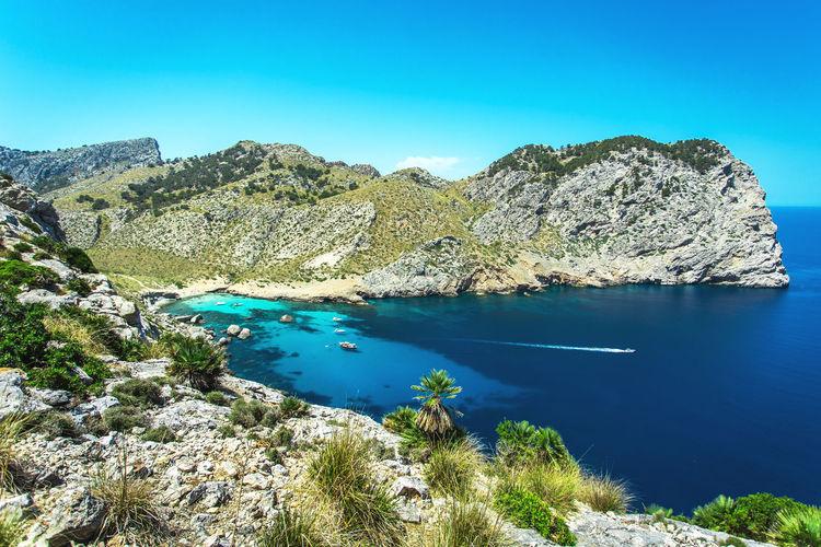 Cala Ferrera beautiful bay view, Mallorca island, Spain Water Beauty In Nature Scenics - Nature Tranquil Scene Tranquility Blue Rock Nature Day Idyllic Yacht Cruising Mallorca SPAIN Vacations Seascape