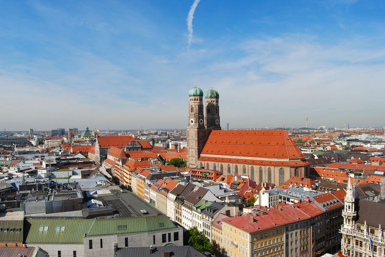 Munich cathedral with cityscape against sky