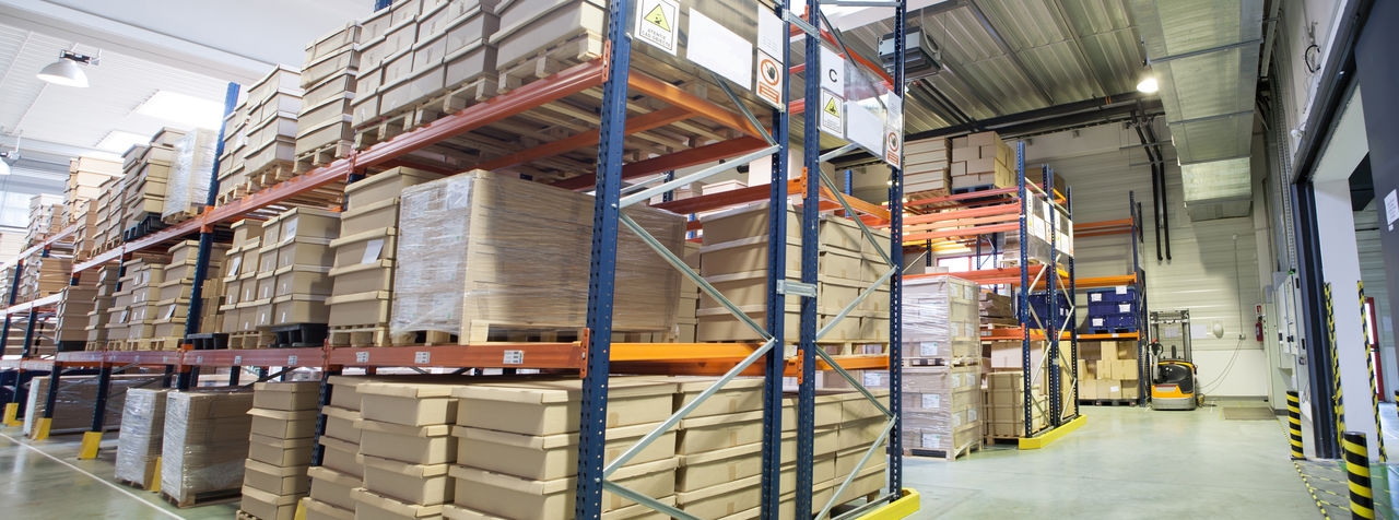 Goods Industry Logistics Service Storage Space Architecture Built Structure Cardboard Box Day Depot Distribution Warehouse Factory Freight Transportation Indoors  Industry Logistic No People Shelf Shelves Shipping  Stack Storage Store Storehouse Warehouse Working