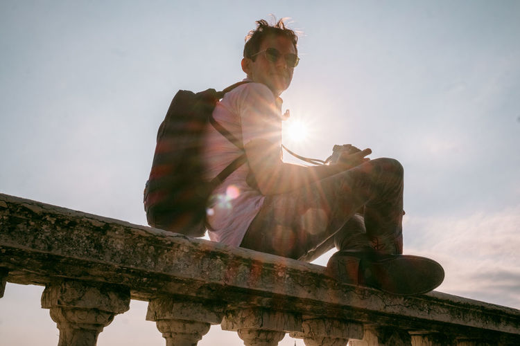 Venice Sky Lens Flare Sunlight Nature Low Angle View Architecture Day One Person Sitting Sun Sunbeam Human Representation Built Structure Representation Sculpture Leisure Activity Outdoors Statue Bright