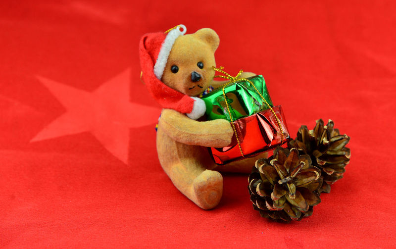 High angle view of stuffed toy against red background