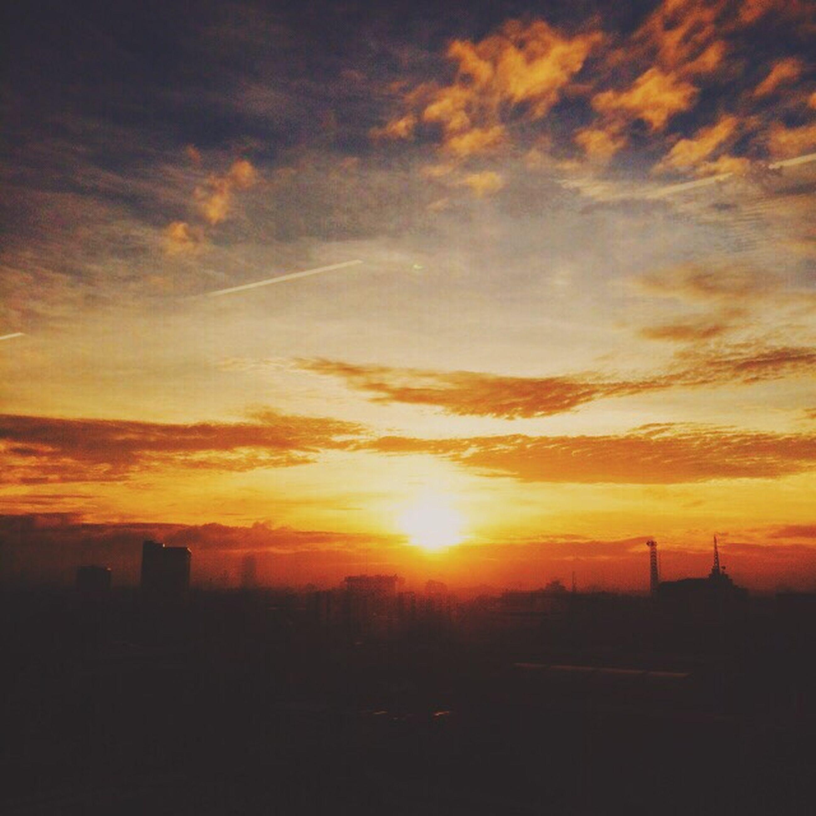 sunset, silhouette, orange color, sky, cloud - sky, beauty in nature, scenics, sun, building exterior, dramatic sky, built structure, architecture, nature, cloudy, cloud, idyllic, tranquility, tranquil scene, landscape, sunlight