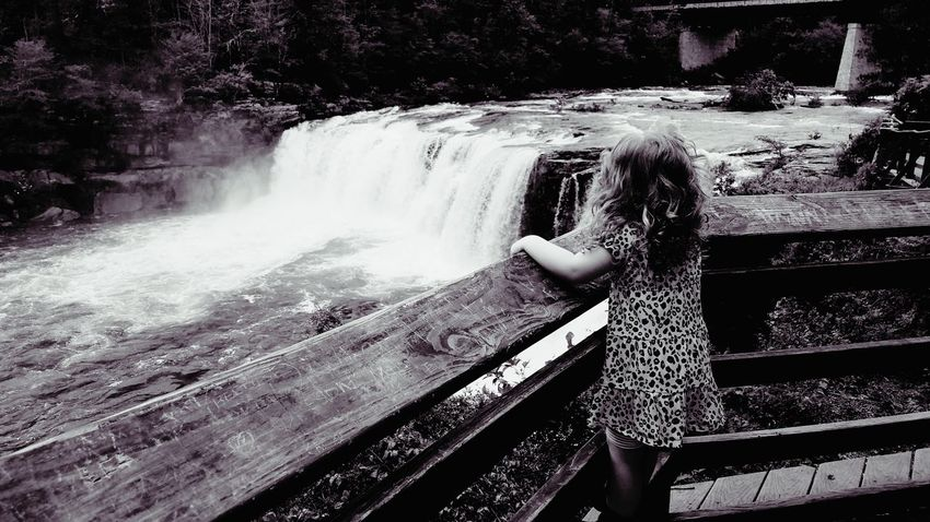 The Portraitist - 2017 EyeEm Awards The Great Outdoors - 2017 EyeEm Awards Contemplative Inspiring Overlook Live For The Story Copyspace Life Background Tranquility Meditation Place Of Heart Backgrounds Child Black And White Toddler  Girl Curls Innocence True Enjoyment Endearing Standing Waterfalls Rewilding