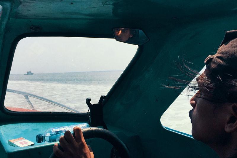 Portrait of man in sea seen from boat