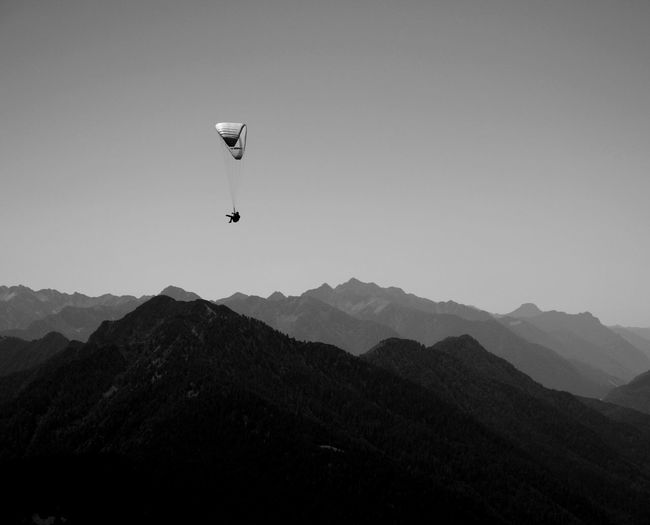 Mountain Mountain Range Sky Scenics - Nature Beauty In Nature Mid-air Adventure Clear Sky Flying Parachute Extreme Sports Sport Outdoors Mountain Peak No People Bnwphotography Bnw_captures Bnw_collection Black And White