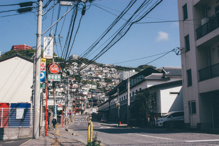Architecture Built Structure Cable Car City City Life Cityscapes Connection Development Electricity Pylon Guidance Japan Land Vehicle Nagasaki Outdoors Perspective Power Line  Road Street Street Light The Way Forward Transportation Urban