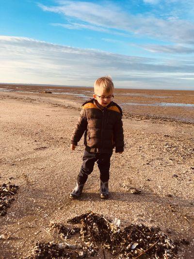 Full length of boy standing at beach