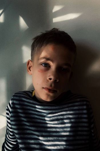 Portrait of boy at home
