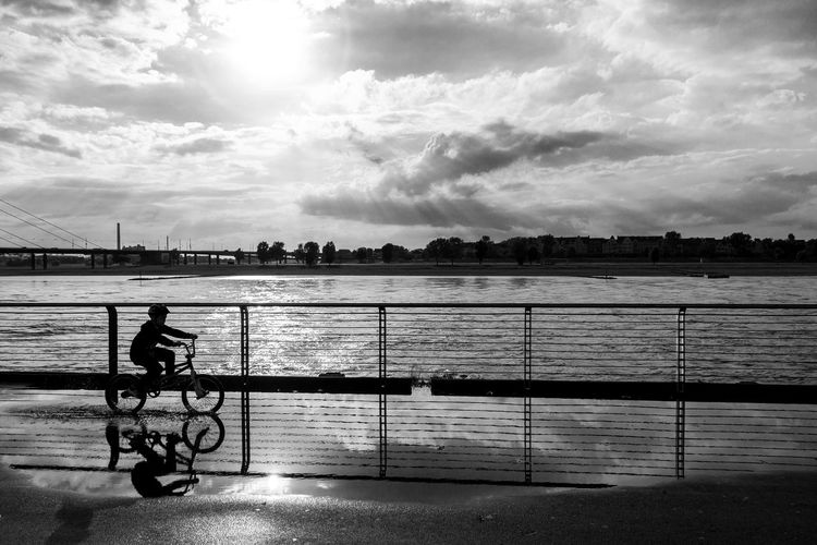 Düsseldorf, Germany Backlight Backlit Bicycle Bike Blackandwhite Cloud Cloud - Sky Fahrrad Fluss Pfütze Puddle Rhein Rhine River Schwarzweiß Sky Sunset Water Monochrome Photography CyclingUnites Black And White Friday