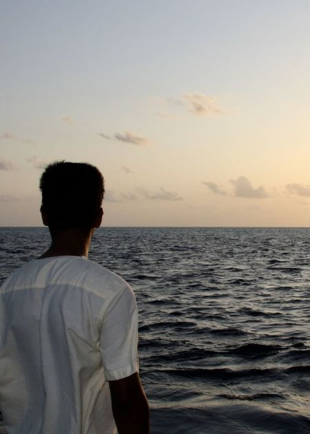 A man standing on a boat watching the sun goes down Back View Backgrounds Clouds Dreaming EyeEm Best Shots Horizon Over Water Indian Ocean Maldives Man Ocean Outdoors Rear View Relaxing Sea And Sky Sky Skyporn Standing Sunset Sunset Silhouettes Sunset_collection Unrecognizable Person Waist Up Water Life Light Been There. Modern Hospitality