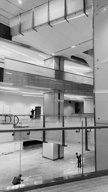 My Year My View Monochrome Photography People And Places Indoors  Full Length Daylight Photography People Cleaning Malls Interiors Glass Structure Architecture Interior Photography Interior Views Interior Design Urban Photography Metal Structure Construction Workers Indoors