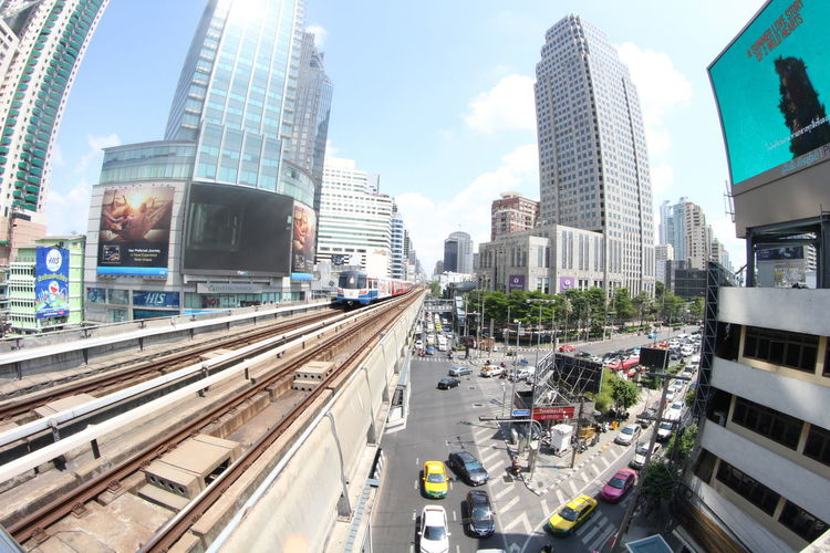 High angle view of railway line amidst buildings in city