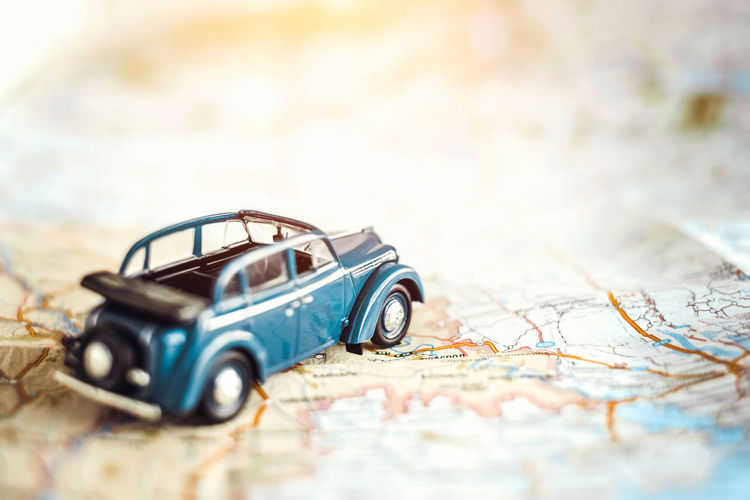Map Selective Focus Travel Toy Transportation Direction Guidance Close-up Journey No People Car Exploration Mode Of Transportation Road Trip Trip Indoors  Copy Space Motor Vehicle Antique Small