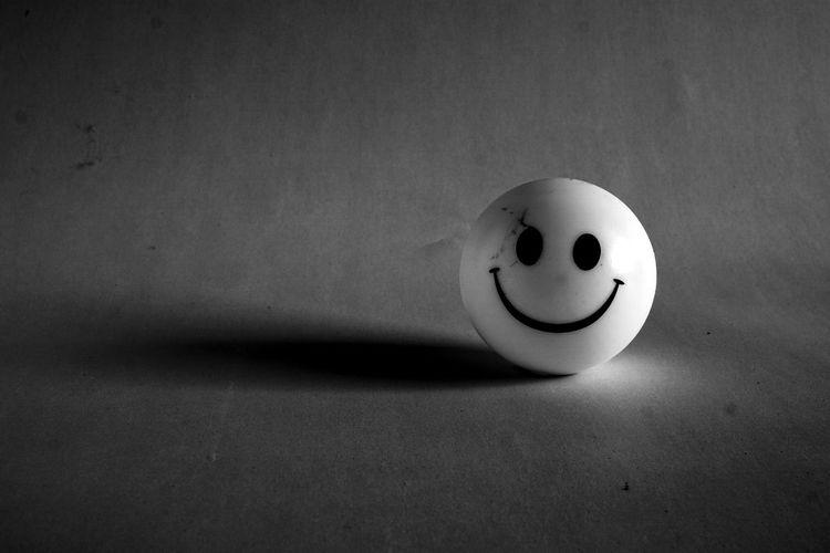 High angle view of smiley ball on floor