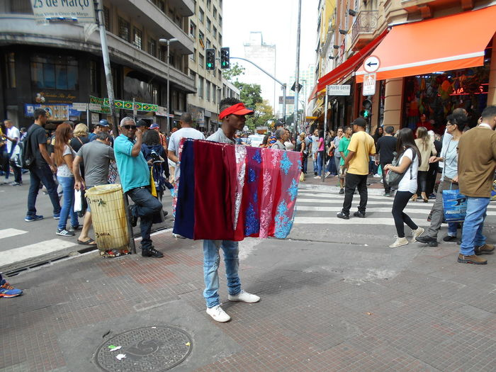 "Susan´s Series: Street Vendors in Downtown São Paulo (often referred to as a ""Micro-Empresa"", or Micro-Business) . And sometimes referred to street trade ""de baixo do pano"" or, the ""under the cloth."" These are the ""invisible"" people who ply their trade day in and day out to meet their customer´s satisfaction. These street vendors, who sell to persons walking by on the street, are to be respected. Despite sometimes unbearable circumstances they chose to try, to sell something, anything, rather than resort to drugs and/or become beggars and homeless. They deserve to be always treated with dignity and respect. (If you want to know the exact location where this photo was taken in downtown São Paulo, just ask.) Arts & Crafts Arts And Crafts Brasil 2018 Dignity Respect Small Business Small Business Heroes Street Vendor Susan A. Case Sabir The Photojournalist - 2018 EyeEm Awards The Street Photographer - 2018 EyeEm Awards Unretouched Photography Commercial District Dignity And Respect Downtown São Paulo Micro-business Microempresa Plying A Trade Selling Selling On The Street Small Business Owner Small Businesses Small But Mighty Street Trade Street Vendors"
