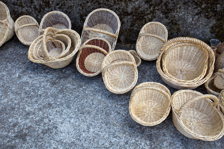 High angle view of wicker baskets on footpath