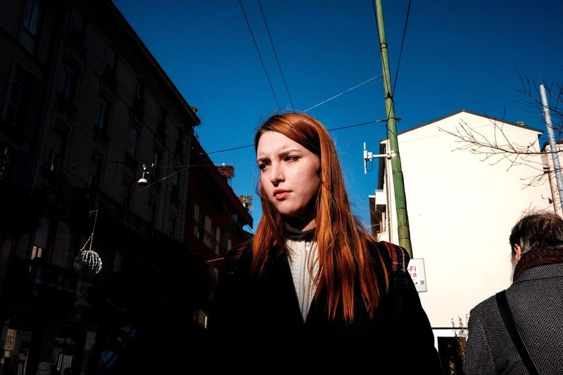 Young woman against clear sky