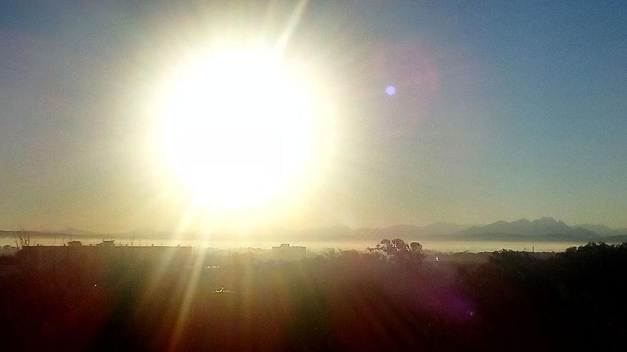 Sunrise Over The Horizon Sunlight Sun Sunbeam Lens Flare Sky
