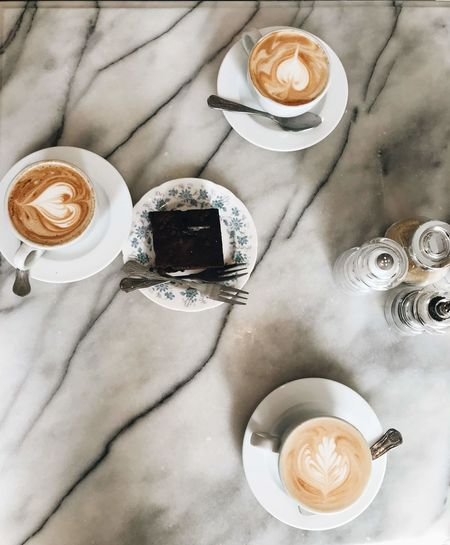 Cappuccino Coffee Coffee - Drink Coffee Cup Crockery Cup Directly Above Drink Food And Drink Freshness Froth Frothy Drink Glass High Angle View Hot Drink Indoors  Latte Mug No People Non-alcoholic Beverage Refreshment Saucer Spoon Still Life Table