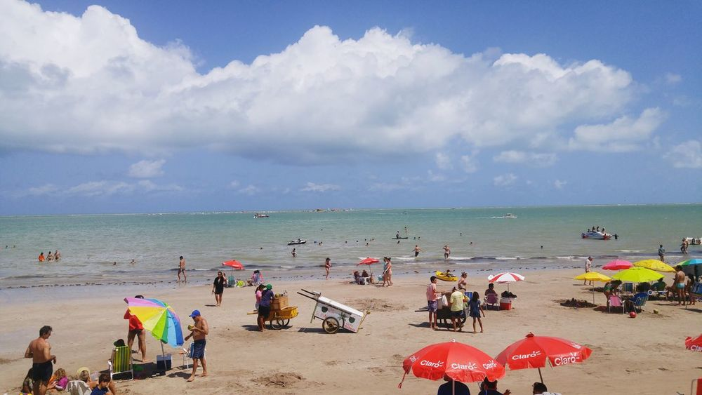 Sea Beach Tourism Travel Destinations Outdoors Water Vacations Scenics Coastline Sky Horizon Over Water Sand Beauty In Nature Large Group Of People People Day Postcard Nature