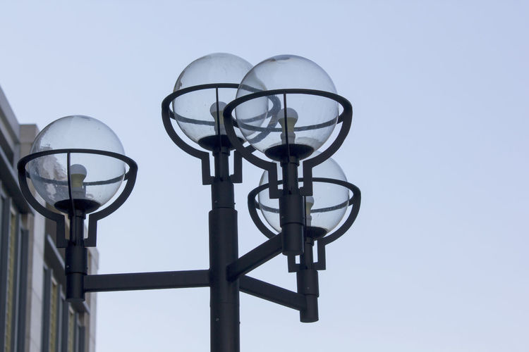 Low angle view of gas light against clear sky