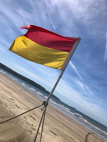Sea West Wales Beach Wales Lifeguard  Iifeguards Flag Sky Multi Colored Flag Nature Beach Land Red Cloud - Sky Day Wind Low Angle View No People Yellow Sand Tilt Sunlight Outdoors Water
