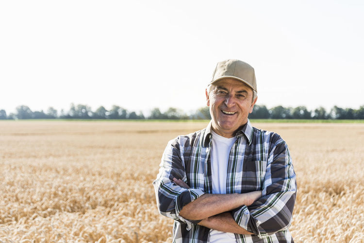 Portrait of smiling man standing in field