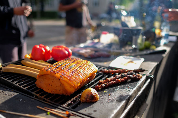 Fresh Food Grilling On Barbecue Against Road