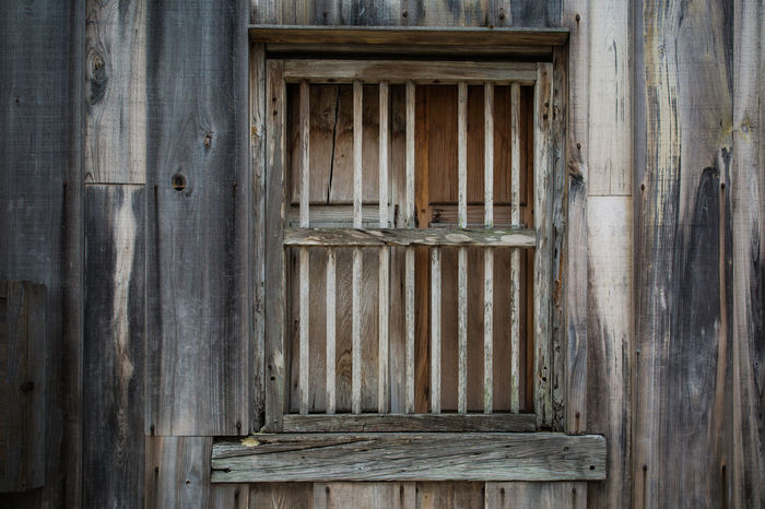 Antique Doors Natural Pattern, Texture, Shape And Form Weathered Wood Architectural Detail Architecture Backgrounds Bars Close-up Day Distressed Door No People Old Architecture Outdoors Pattern Texture Window Wood - Material